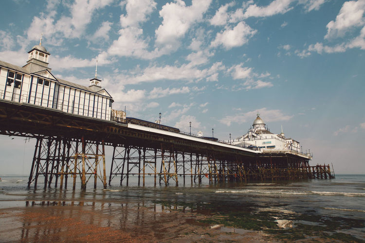 Eastbourne Pier At Beach Against Sky