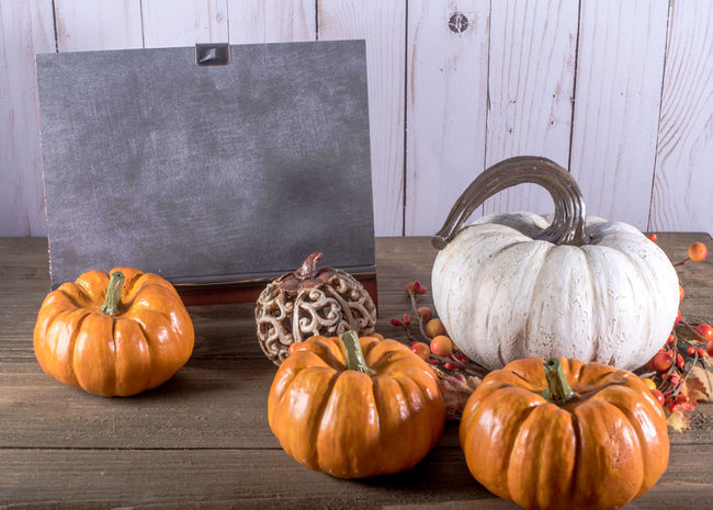 Blank Chalkboard with five pumpkins Autumn Text Thankgsiving Autumn Celebration Event Chalk Chalkboard Day Food Freshness Gourd Halloween Healthy Eating Indoors  No People Pumpkin Pumpkin Seed Squash - Vegetable Still Life Vegetable Wood - Material