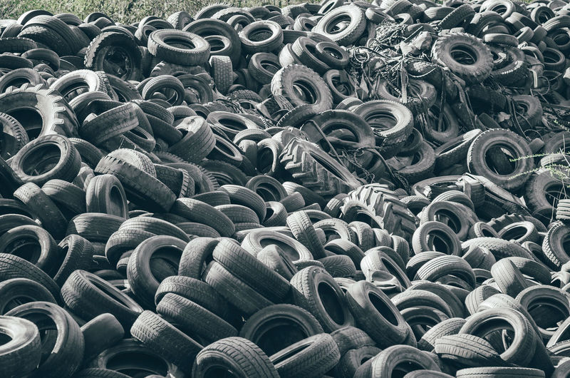 Landfill of old car tires torn spoiled abandoned.