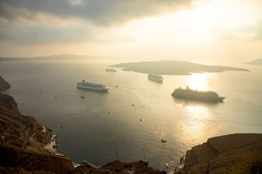 Greece Santorini Oia Thira Water Sea Scenics - Nature Sky Tranquility Tranquil Scene Beauty In Nature Cloud - Sky Nature Land Rock High Angle View No People Nautical Vessel Sunset Beach Transportation Idyllic Mode Of Transportation Outdoors Bay