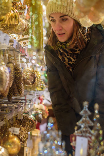 Woman by decoration in market