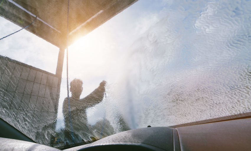 Car Wash Cleaning Windows Body Part Car Cloud - Sky Day Human Arm Human Body Part Human Limb Leisure Activity Lifestyles Men Mode Of Transportation Nature One Person Outdoors Personal Perspective Real People Sky Sunlight Transportation Water Water Surface Young Adult