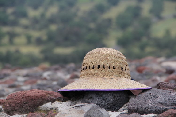 Close-up of hat on rock