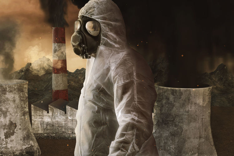 survivor with white overall and gas mask in front of incineration plant and apocalyptic environment Gas Mask Pollution Incineration Plant Power Plant Apocalyptic Smog Protective Suit Chemical Toxic Contamination Mask Smokestack Dioxin Environment Chimney Industrial Thick Dirty Apocalypse Protection Side View