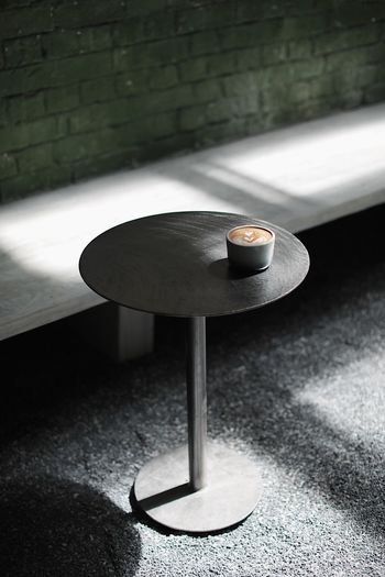 High angle view of coffee on table against wall