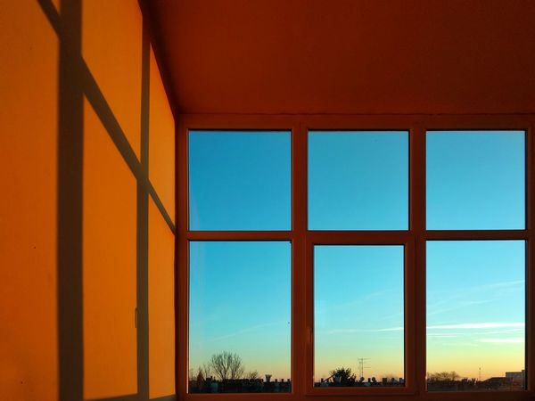 Sunset window Sunset Light Sunset Colors Windows Glass Golden Hour Window Architecture Sky No People Day Cloud - Sky Indoors  Built Structure The Graphic City Colour Your Horizn The Architect - 2018 EyeEm Awards