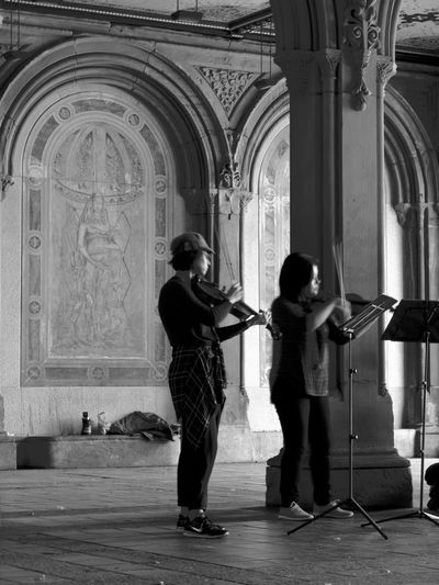 musicians at Central Park Adult Architecture Arts Culture And Entertainment Day Full Length Indoors  Music Musical Instrument Musician People Person Two People Vertical Violonist