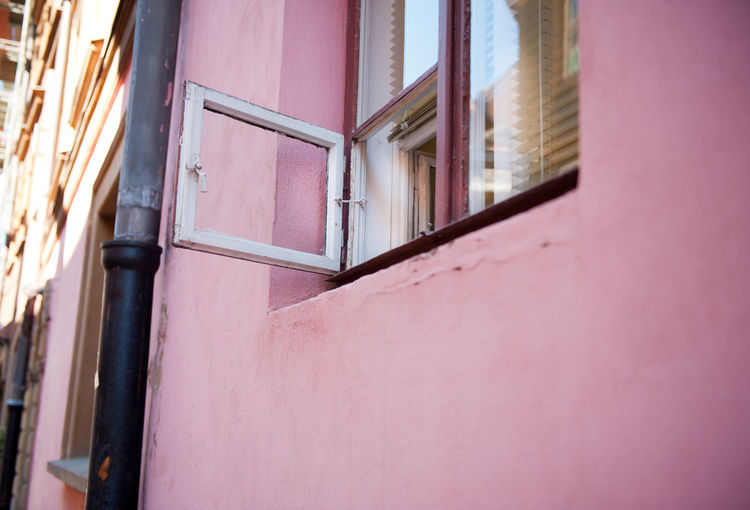 Open wood small ventilation window and pink wall in Warsaw, Old Town in Poland. Small part of window Polish lufcik, Russian fortochka, pane vent window with blinds in tenement house. Horizontal orientation, nobody. Aerate Architecture Blinds Building Building Exterior Built Structure Casement Drainpipe Fortochka Gutter Home House Lufcik No People Old Open Millennial Pink Outdoors Pane Pink Tenementhouse Vent Ventilation Wall Window