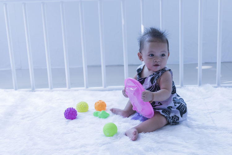 Portrait of cute girl playing with toy