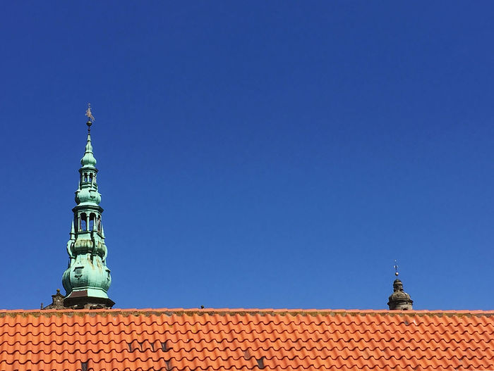 High section of kronborg castle roof against clear blue sky