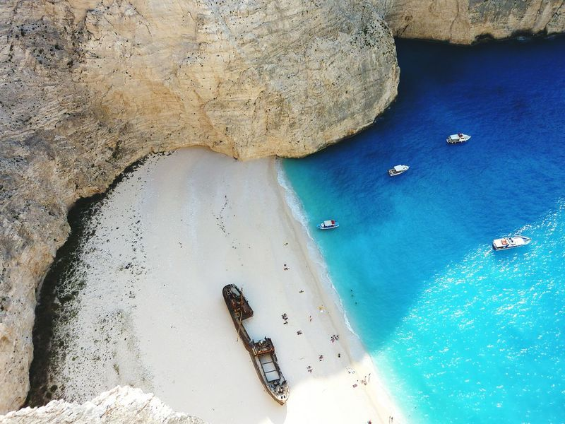Shipwreck Shipwreck Bay Sand Beach Outdoors Sea Nature Water Day Beauty In Nature No People Beauty In Nature Rocks Summer Turquoise Water Tranquility Scenic Beauty Zakynthos Greek Island Lost In The Landscape