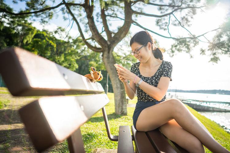 Capturing Pokémon Casual Clothing Leisure Activity Lifestyles Nature Outdoors Pokemon Go Pokémon Relaxation Singapore Sitting Tree