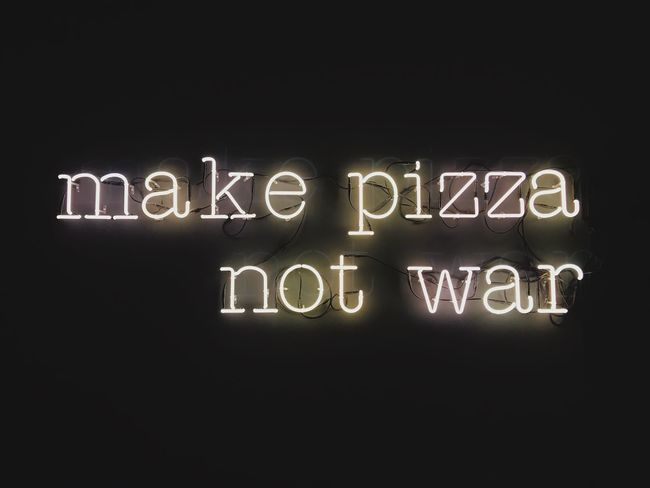 make pizza not war Make Pizza Not War No War War Make Pizza Pizza Text Communication Western Script Illuminated Night No People Copy Space Message Capital Letter Writing Glowing Lighting Equipment Indoors  Neon Dark Black Background Sign