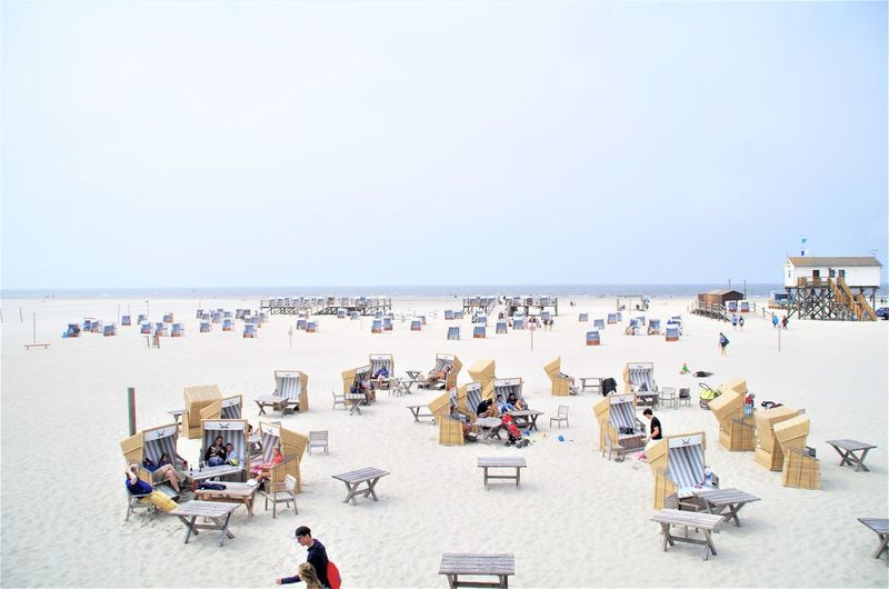 Crowded German Beach in St. peter ording St. Peter Ording Strandkorb Strandkörbe Beach Chair Crowd Day Group Of People High Angle View Holiday Horizon Horizon Over Water Land Large Group Of People Nature Outdoors Sand Sea Sky Travel Travel Destinations Trip Vacations Water