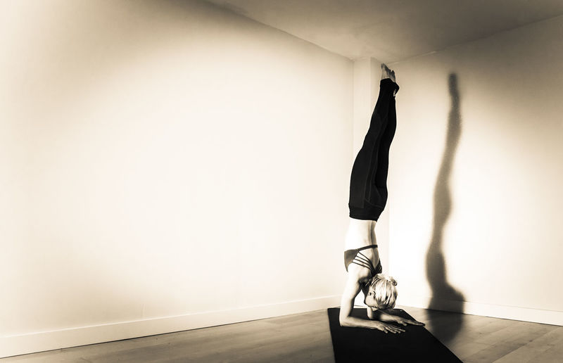 """""""Down Up"""" /// I used a reflector for the first time and had the luck that a beam of direct sun light hit through a ceiling window to light my amazing model. Sepia Blackandwhite Woman Female Model Yoga Yoga Pose Namaste ❤ Handstand  Forearm Stand Sunlight And Shadow"""