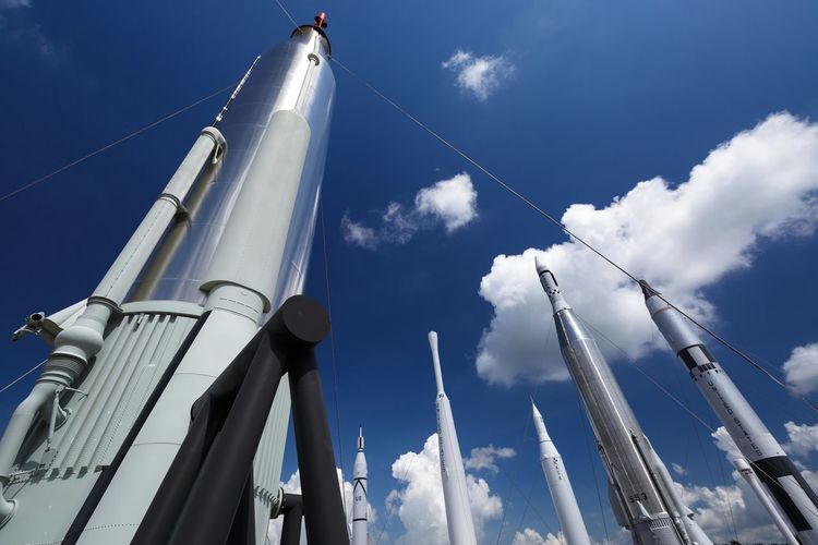 Low Angle View Of Rockets Against Sky At Kennedy Space Center In Cape Canaveral