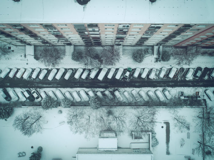 Aerial view of snow covered cars parked on parking lot