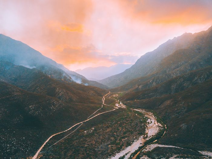 Fire. Mountain Tranquil Scene Beauty In Nature Tranquility Scenics Mountain Range Nature Outdoors Sunset No People Landscape Winding Road Sky Day