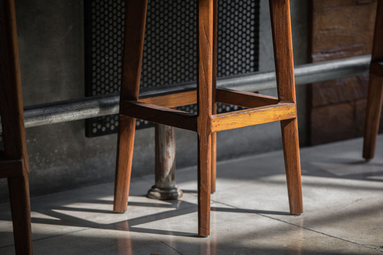 Bottom of wooden bar chair, Seminyak Seat Chair Indoors  Wood - Material No People Table Flooring Absence Empty Furniture Architecture Brown Day Building Shadow Focus On Foreground Pattern Home Interior Tiled Floor EyeEm Best Shots Eye Em Gallery Eye Em Around The World Eye Em Best Edits