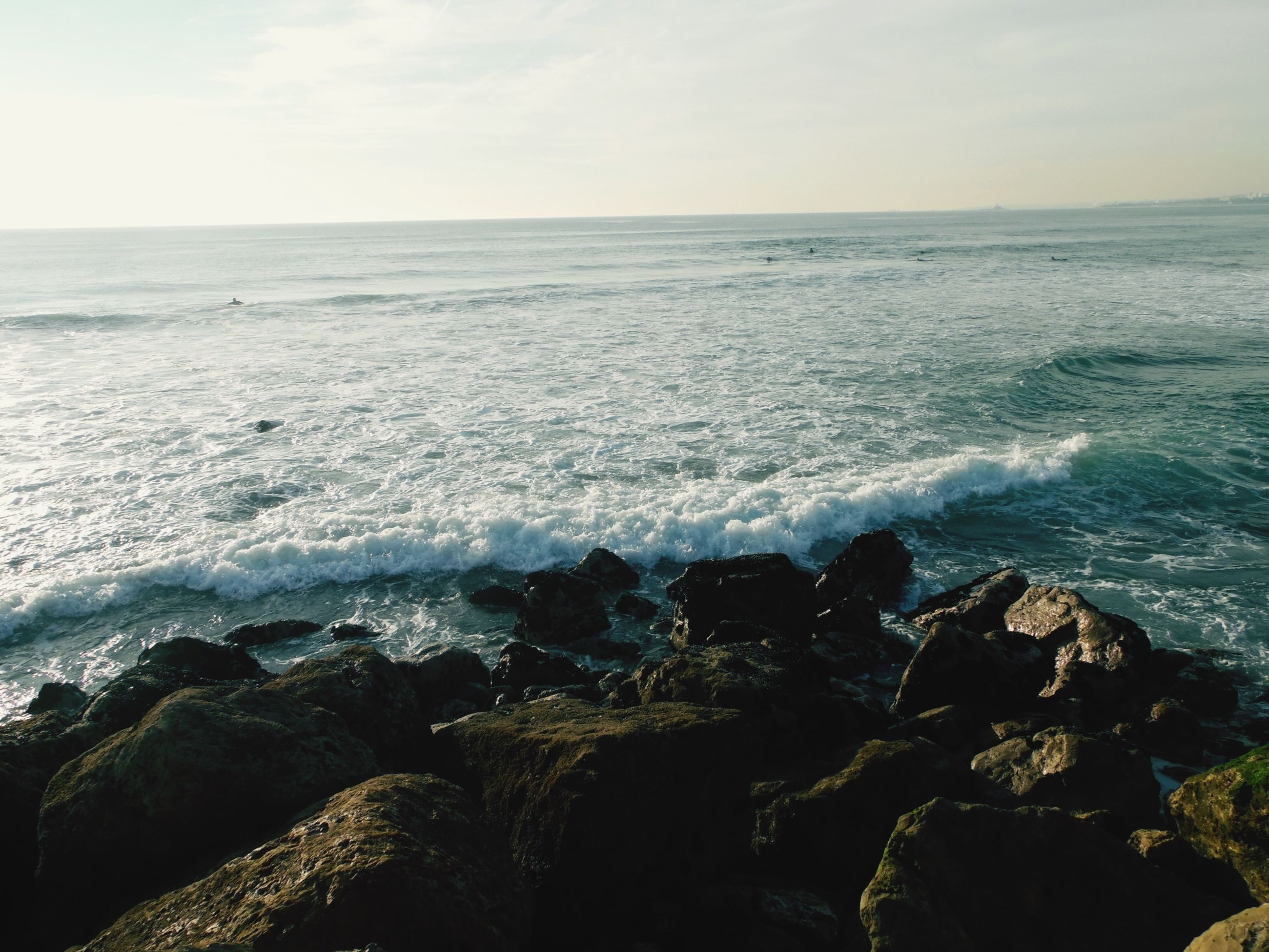 sea, horizon over water, water, scenics, beauty in nature, wave, tranquil scene, sky, tranquility, nature, rock - object, beach, shore, surf, idyllic, seascape, rock formation, coastline, cliff, outdoors