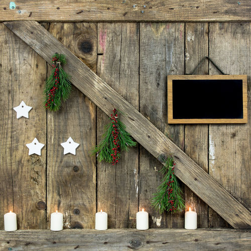 High angle view of christmas decorations on wooden wall