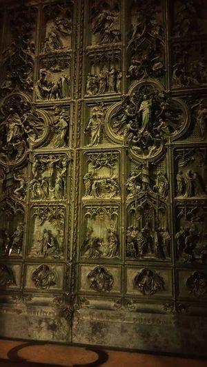 Duomo front doors Milan Italy