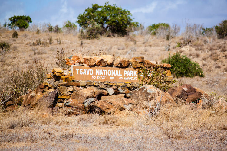 Africa Cloud - Sky Day Hill Information Sign Landscape Mountain National Park Nature Nature No People Non-urban Scene Outdoors Plant Rural Scene Safari Safari Animals Sky Tranquil Scene Tranquility Tree Tsavo Village Water Wild Animal