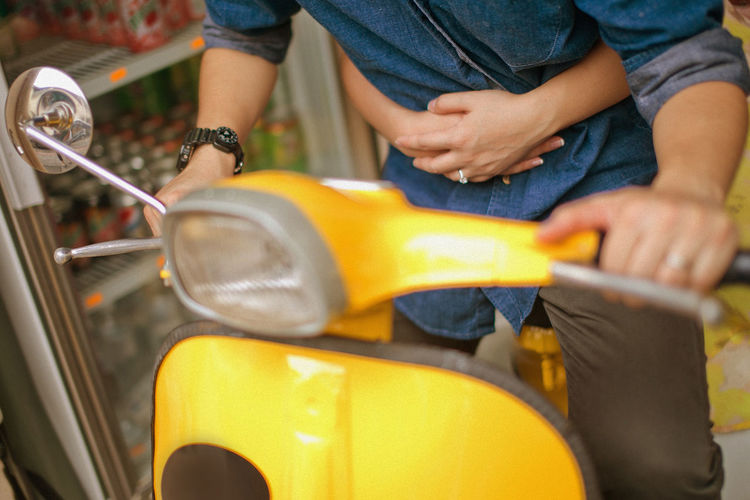 Togetherness Casual Clothing Transportation Men Mode Of Transportation Real People Selective Focus City Land Vehicle One Person Holding Midsection Day Hand Street Leisure Activity Lifestyles Human Hand Car Outdoors Vespa Vintage Yellow Togtherness Relationship