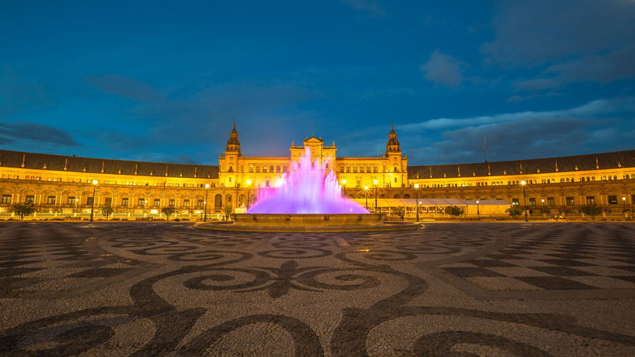 Night at Plaza de Espana, with violet moving fountain at sunset from dusk to night Seville Seville Plaza De Espana Seville's Cathedral SevilleSpain Architecture Building Building Exterior Built Structure City Cloud - Sky Fountian Government History Illuminated Nature Night No People Outdoors Seville Spain Plaza Seville, Spain Seville,spain Sky Spain ✈️🇪🇸 The Past Tourism Travel Travel Destinations