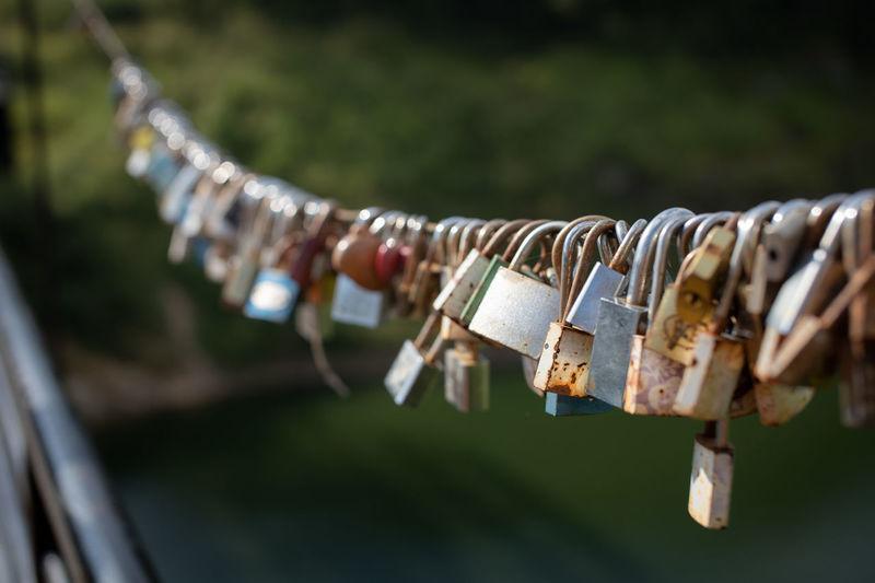 Close-up of padlocks on railing