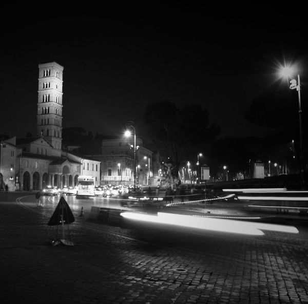 City Night Illuminated Building Exterior Cultures Architecture Outdoors Scenics Reflection Lights City Roma Cars Carlights Citylife Lines Long Exposure Monochrome Photography Works Road Closed Sign Workinprogress Moving Around Rome