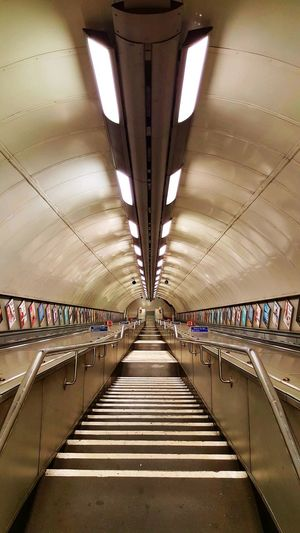 Ceiling Symmetry Architecture No People Hyde Park Corner Empty Places Indoor Lighting Illuminated Built Structure Architecture Empty Hyde Park Corner Station Tube Station  Travel Tube Stairs Down Stairs Staircase Ceiling Transportation Railroad Station