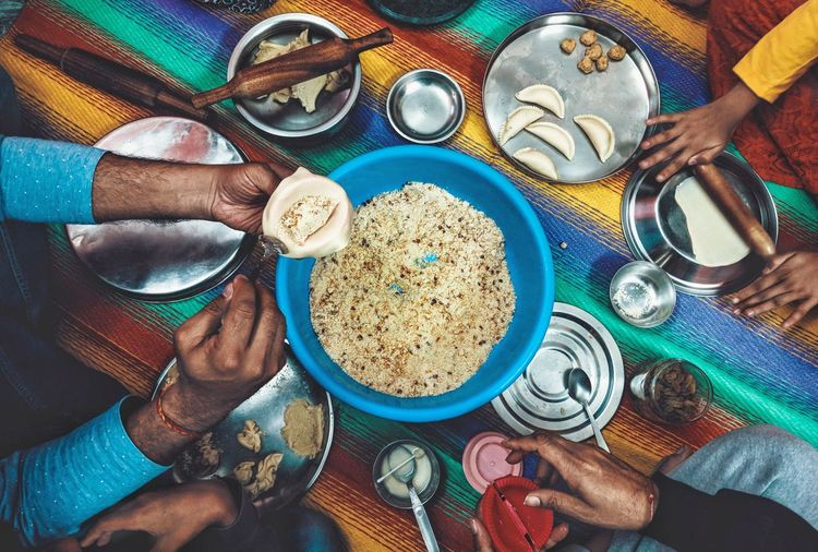 Holi Gujiya Prep Festival India Family Colorpop Human Hand Table Close-up Prepared Food