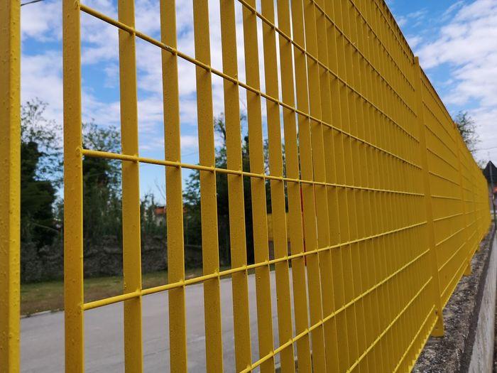 Fence in metal grating Yellow Railing Railing Line Architecture Railing Fence Railing Line Architecture Railing Line Fence Sky Confined Space