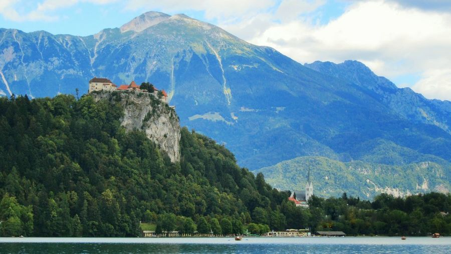 Scenic view of lake by mountain at bled