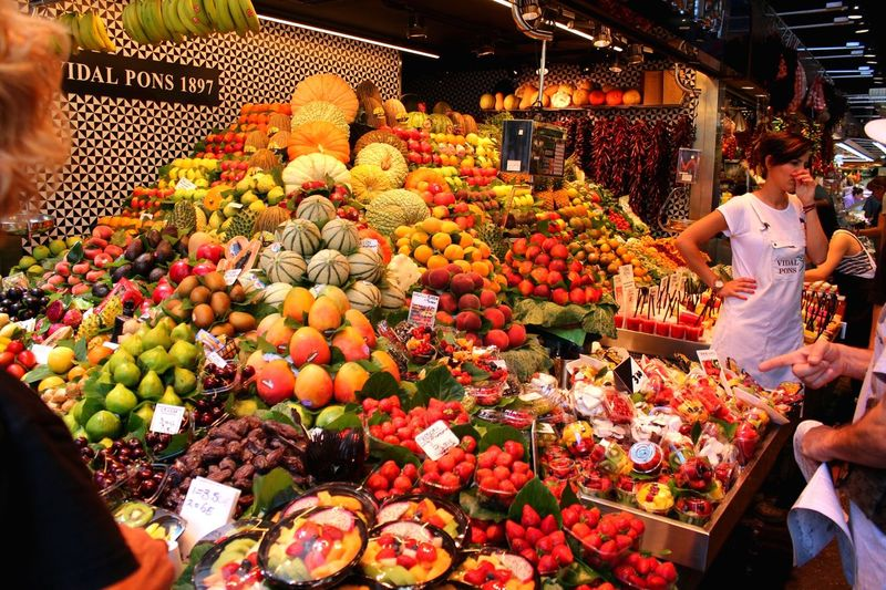 Retail  Market Abundance Market Stall Choice Variation Customer  Fruit Food Freshness Large Group Of Objects Food And Drink Consumerism Buying High Angle View Business People Adults Only Vegetable Merchandise
