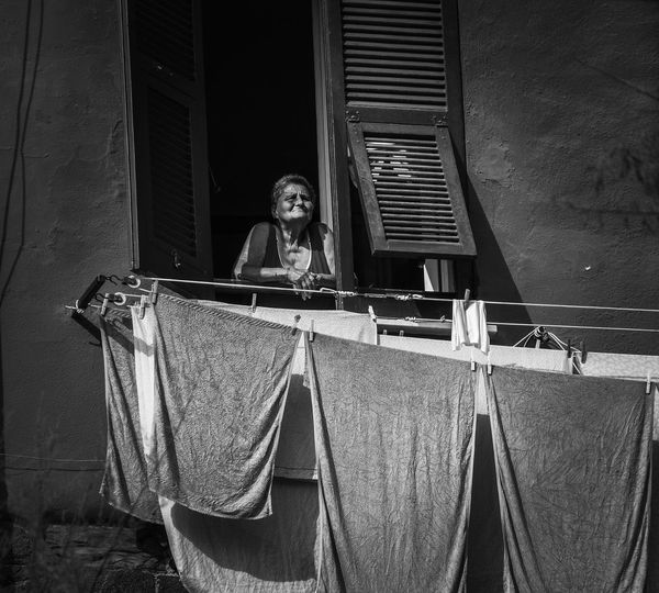 Time goes to my window Real People Women Summer Streetphotography Dolcevita  Window Looking Through Window