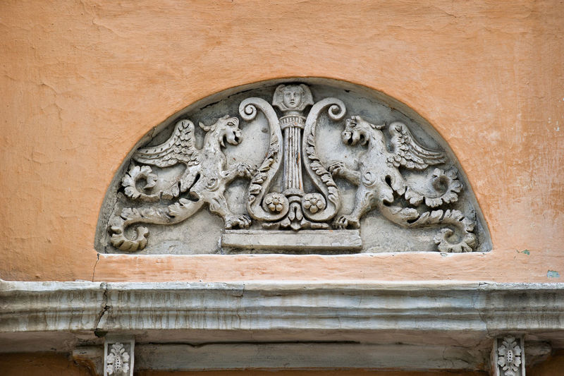 Low angle view of carving on wall of historic building