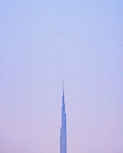 burj khalifa Air Vehicle Airplane Airshow Architecture Building Built Structure Burj Khalifa Burj Khalifa, Dubai Clear Sky Copy Space Day Dubai Dubaicity Fighter Plane Flying Low Angle View Minimalism Nature No People Outdoors Sky Smoke - Physical Structure Space Transportation Vapor Trail