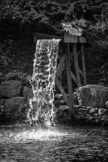 Architecture Beauty In Nature Black & White Black And White Built Structure Day Flowing Water Forest Light And Shade Light And Shadow Long Exposure Monochrome Motion Nature No People Outdoors Splashing Tree Water Water Wheel Waterfall Watermill