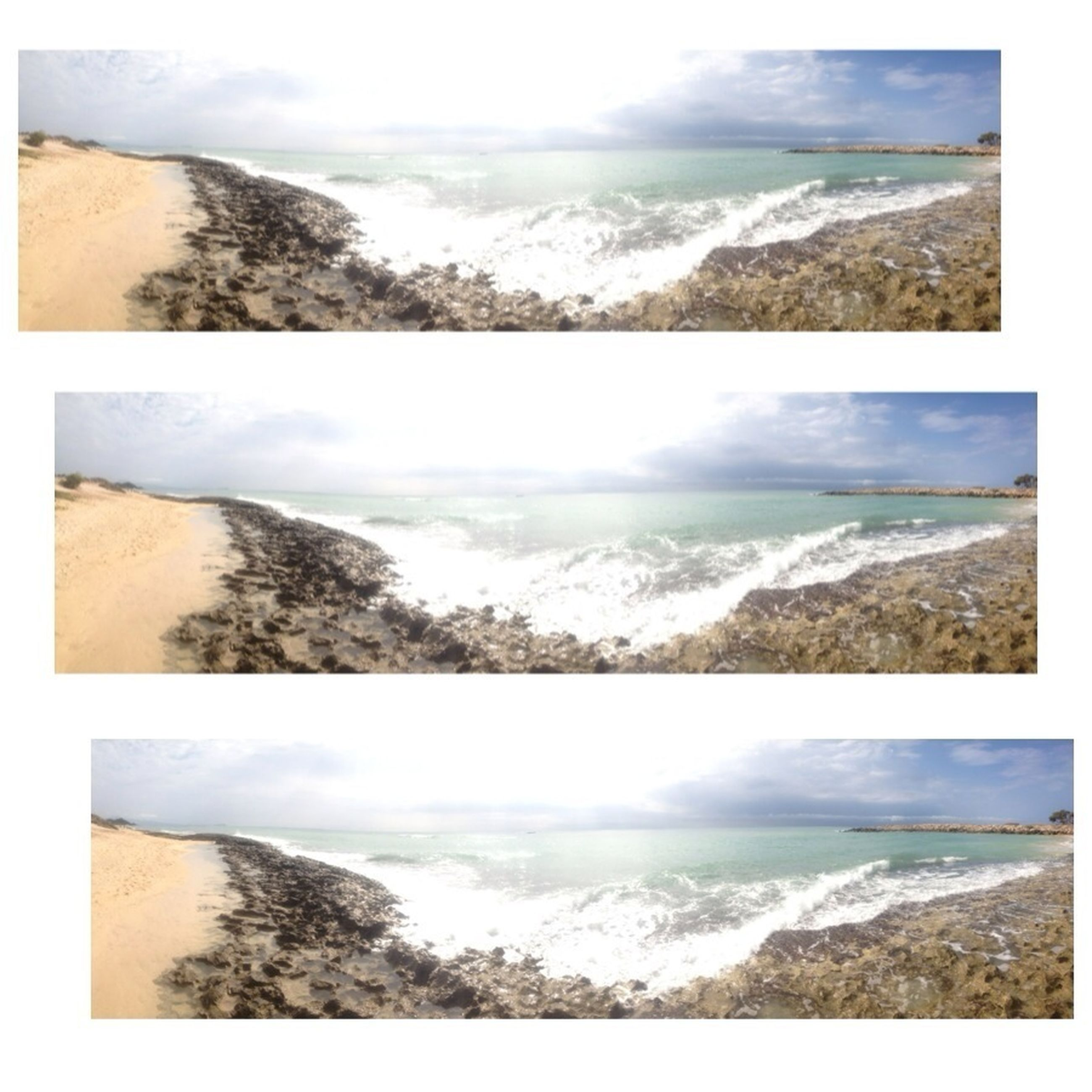 transfer print, water, sea, auto post production filter, scenics, surf, beauty in nature, tranquil scene, wave, horizon over water, tranquility, nature, beach, shore, coastline, sky, high angle view, mountain, day, idyllic