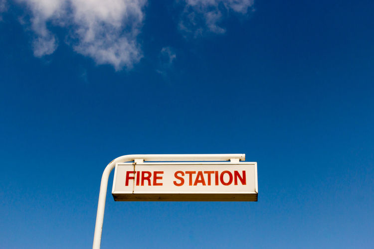 Information sign against blue sky