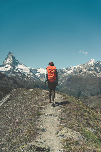 Matterhorn  Zermatt Adventure Backpack Beauty In Nature Clear Sky Climbing Day Full Length Hiking Leisure Activity Lifestyles Men Mountain Mountain Range Nature One Person Outdoors People Real People Scenics Sky Standing Switzerland Walking