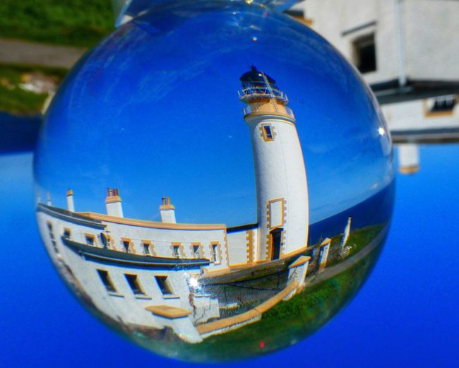 Tiumpan Head Lighthouse through the glass ball Lighthousephotography Lighthouse Glass Ball Stornoway Isle Of Lewis Blue Built Structure No People Close-up Building Exterior Architecture Water Nature Day Nautical Vessel Focus On Foreground Outdoors Reflection Transportation Building Sphere Travel Sky