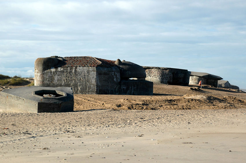 "Remains of the ""Atlantic Wall"" at the beach in Denmark. These Bunkers remain at the beach after having been abandoned at the end of WW2 Bunker Nature WW2 Leftovers Architecture Beach Building Exterior Built Structure Day Fortress Landscape Nature No People Outdoors Sky Stronghold Ww2"