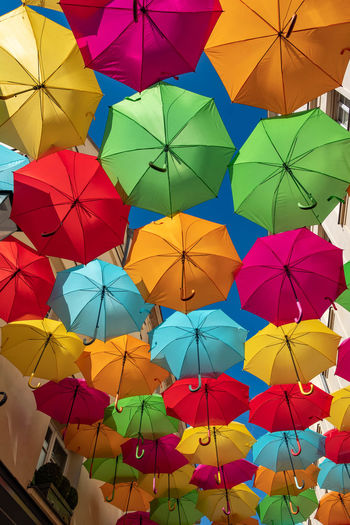 Low angle view of multi colored umbrellas hanging
