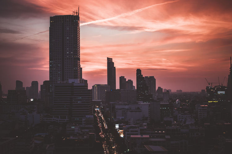 Photo taken from a skyscraper in Bangkok at sunset. Shot taken in January 2018, Bangkok Orange Orange Sky Red Thailand Traffic Traffic Jam Airplane Architecture Building Exterior Built Structure City Cityscape Cloud - Sky Clouds Day Illuminated Modern No People Outdoors Sky Skyscraper Sunset Travel Destinations Urban Skyline Colour Your Horizn