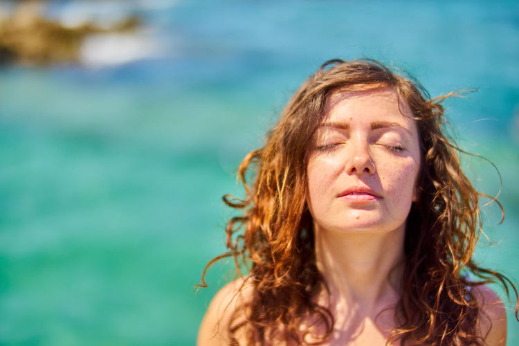 Adult Adults Only Beach Beautiful People Beautiful Woman Beauty Close-up Curly Hair Day Eyes Closed  Focus On Foreground Headshot Long Hair Nature One Person One Woman Only One Young Woman Only Only Women Outdoors Portrait Redhead Summer Water Young Adult Young Women