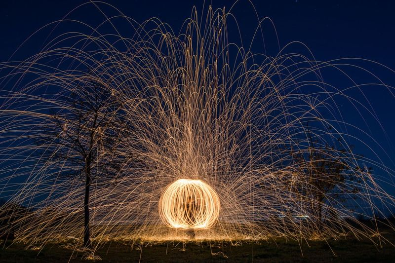 The Fire Play Long Exposure Motion Night Sparks Wire Wool Spinning Illuminated Light Painting Burning Firework - Man Made Object Fireball Outdoors