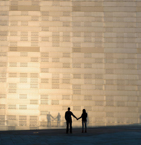 Couple making shadows on a wall in the golden evening sunlight; at Oslo Opera House. EyeEmNewHere Golden Sunlight Standing Silhouette Building Exterior Positive Emotion Oslo Opera House Romantic Golden Hour Golden Evening Shadow Couple - Relationship Togetherness Outdoors Real People City Love Architecture Two People Streetphotography